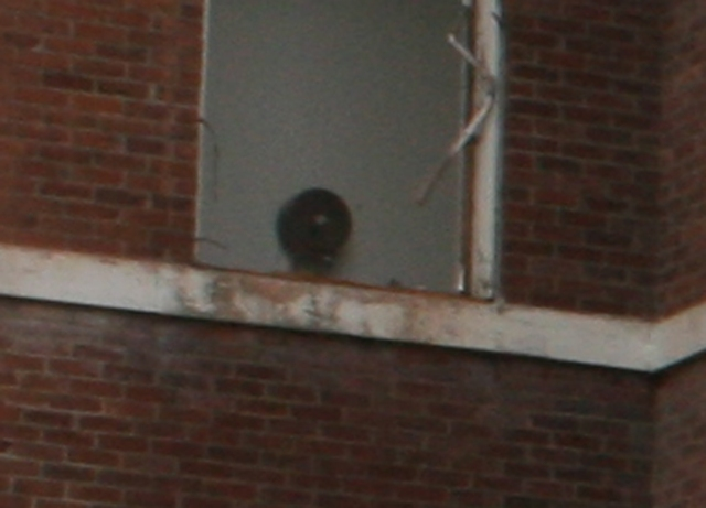 Close up of supposed ghost in window, which really shows a forgotten school fixture