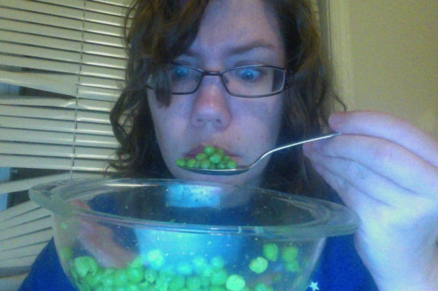 Staring at peas. Looking sad.
