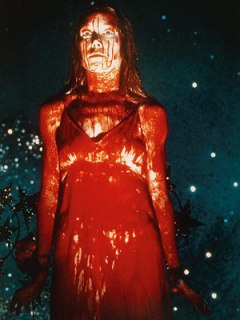 "Scene from the movie ""Carrie"" whereby Carrie is all covered in pigs blood"